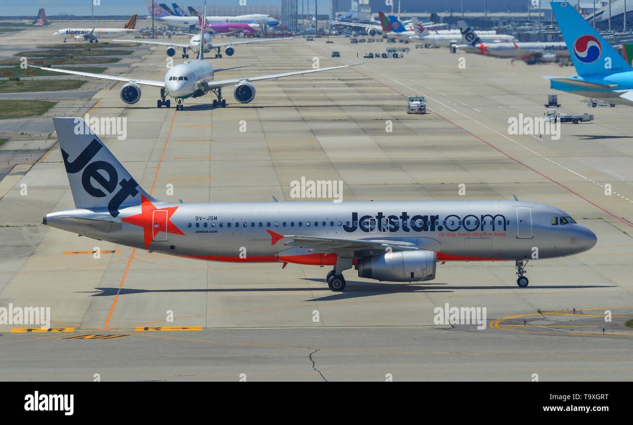 Osaka, Japan - Apr 18, 2019.  9V-JSM Jetstar Asia Airbus A320 taxiing on runway of Kansai Airport (KIX) in Osaka, Japan. - Stock Image