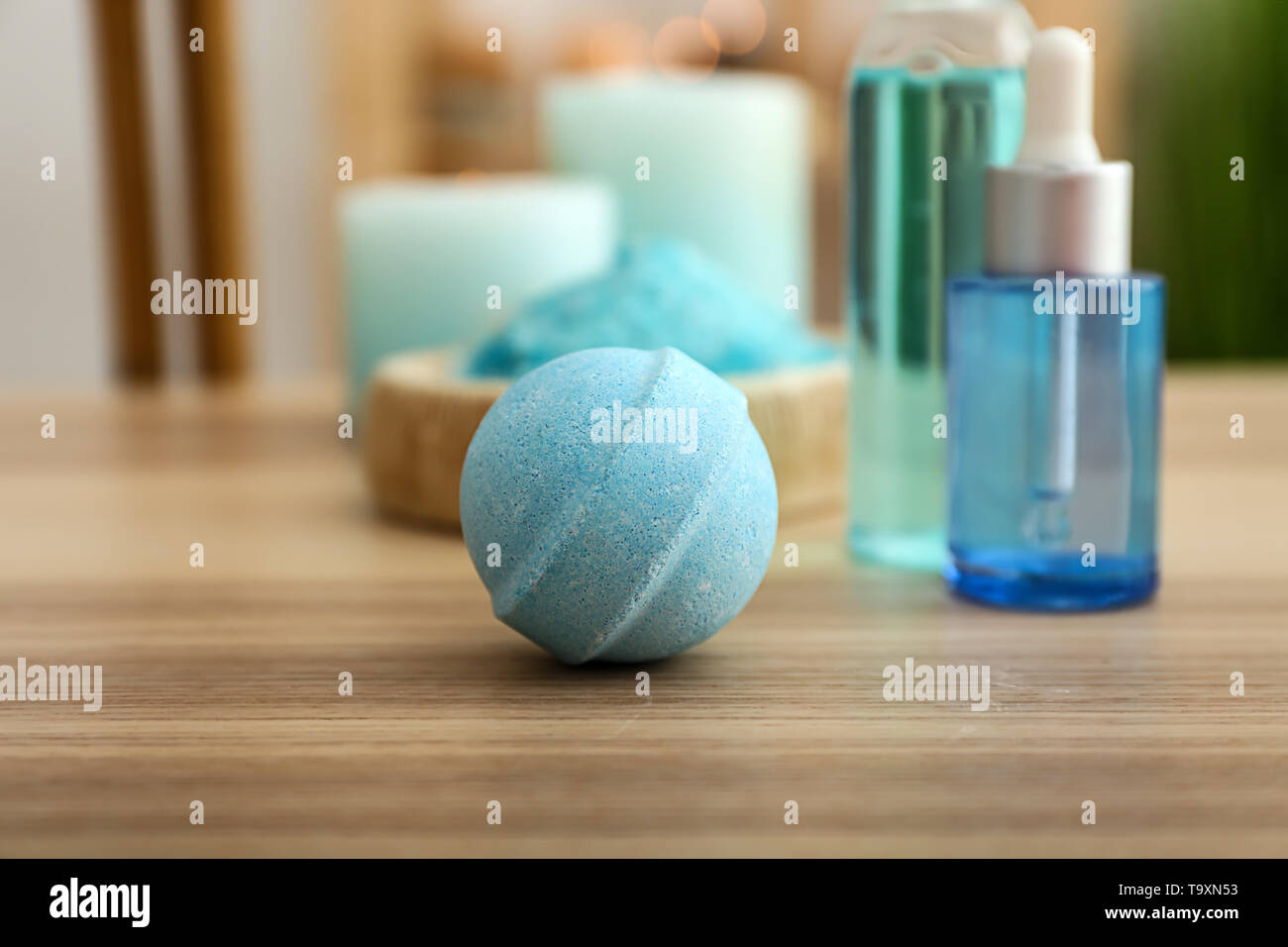 Bath bomb on wooden table - Stock Image