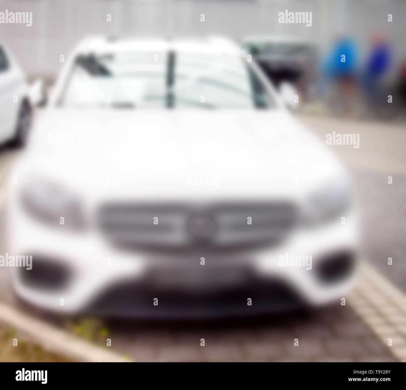 strong blurred, new modern cars on road. The latest model for fans - Stock Image