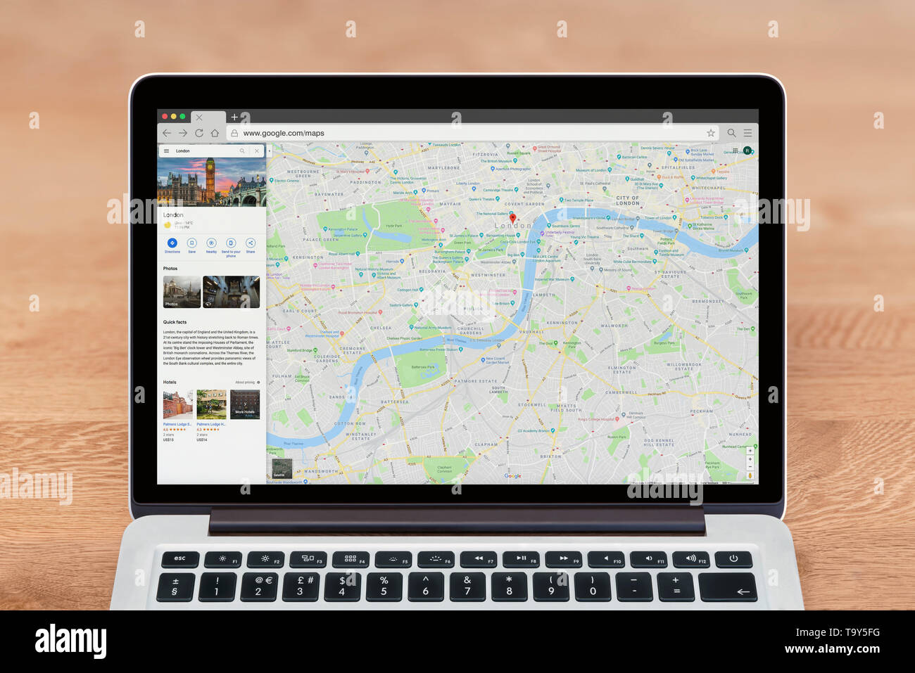 An Apple Macbook displays the Google Maps website (Editorial use only). - Stock Image