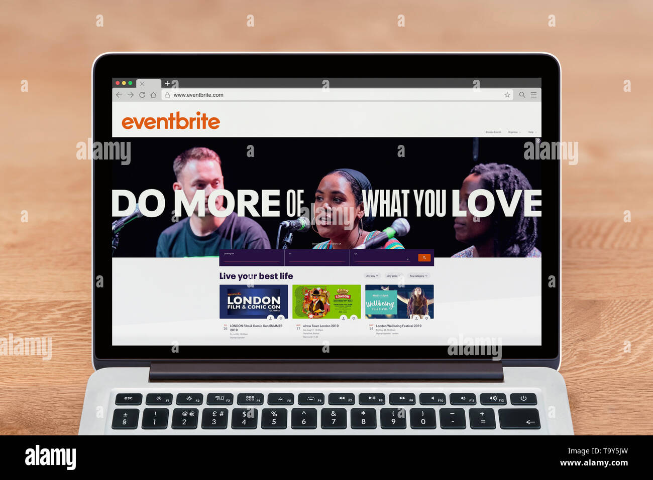 An Apple Macbook displays the Eventbrite website (Editorial use only). - Stock Image