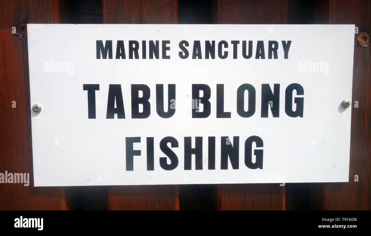 Marine sanctuary sign saying No Fishing in Bislama, Efate, Vanuatu. No PR - Stock Image