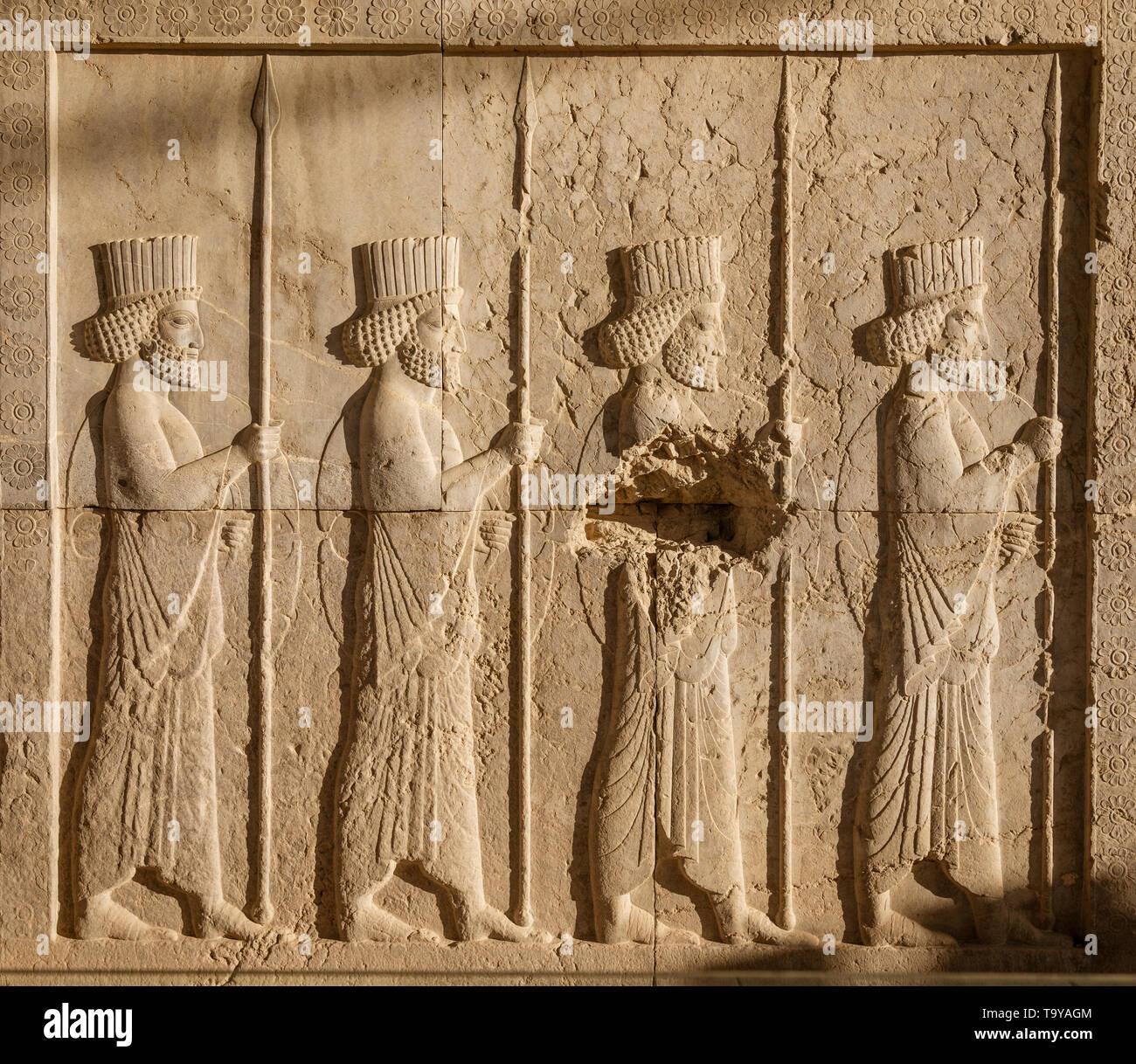 Bas relief carvings at persepolis in shiraz iran stock photo