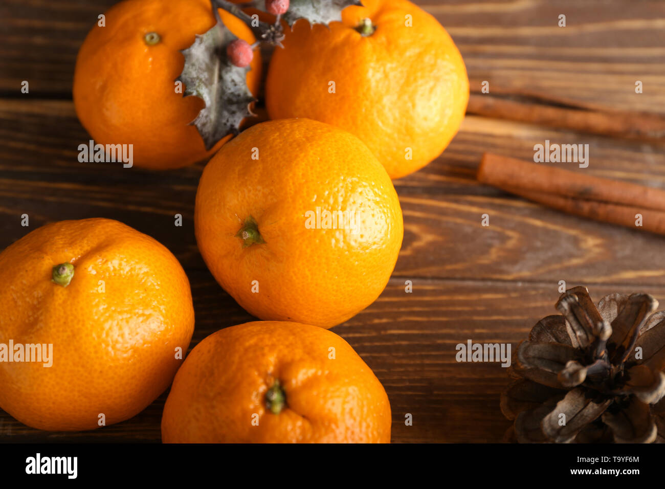 Ripe sweet tangerines on wooden background - Stock Image