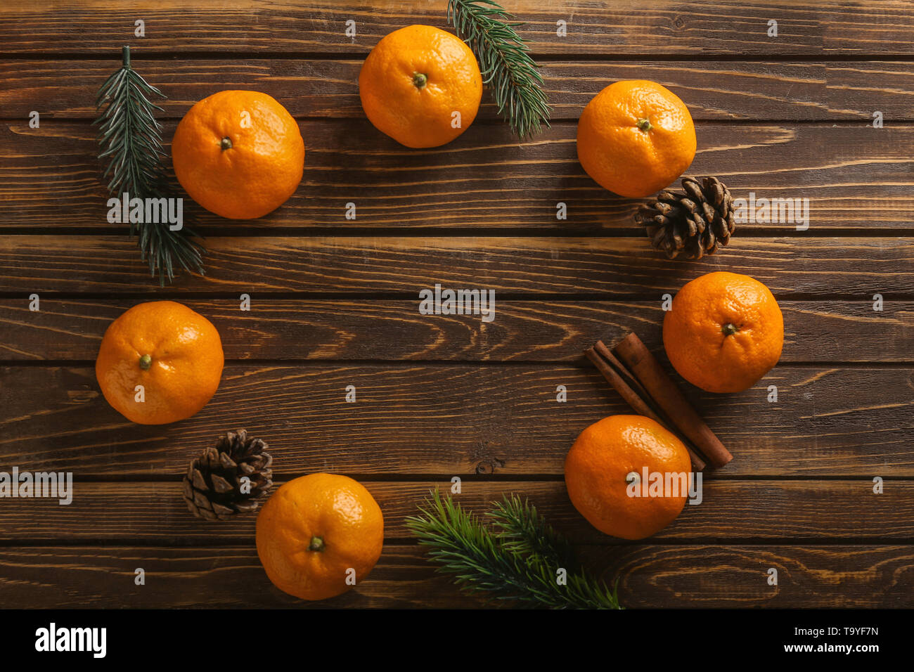 Christmas composition with ripe sweet tangerines on wooden background - Stock Image