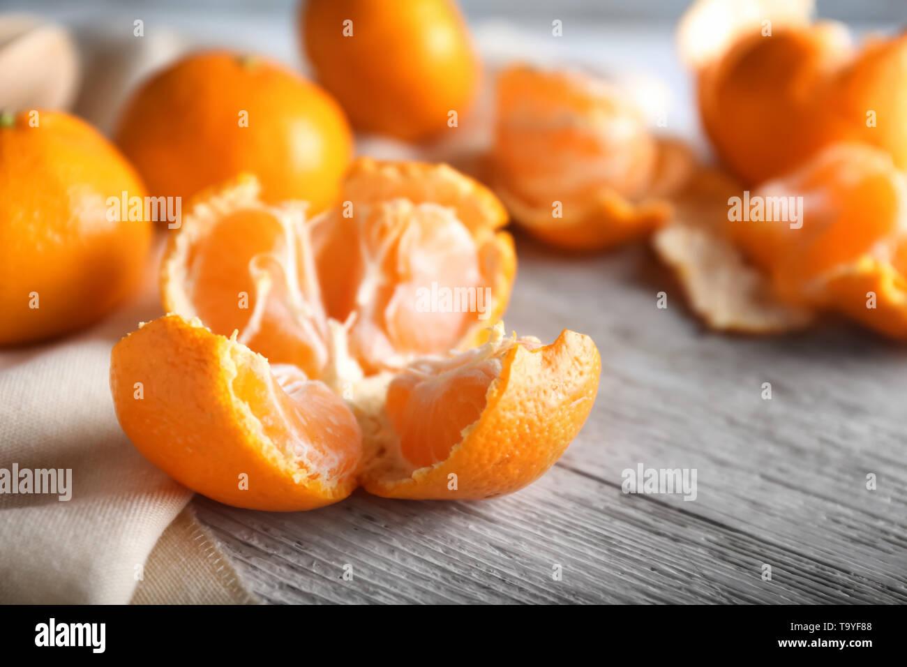 Ripe sweet tangerine on wooden table - Stock Image