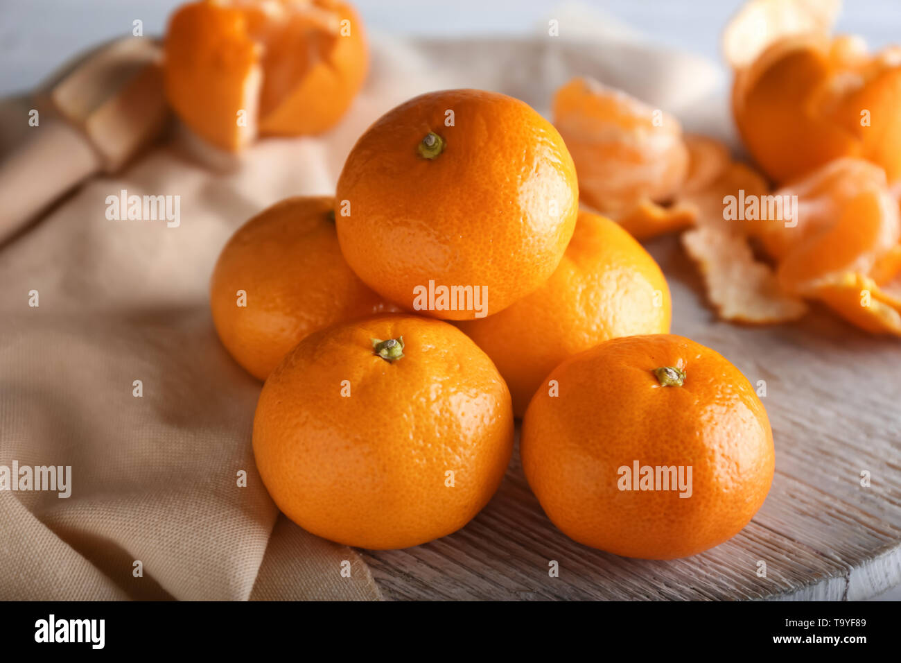 Ripe sweet tangerines on wooden table - Stock Image