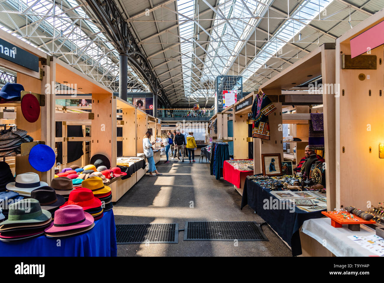 London, UK - May 14, 2019:  Old Spitalfields market with unidentified people. Independent stall holders showcasing handcrafted pieces. The market  hos Stock Photo