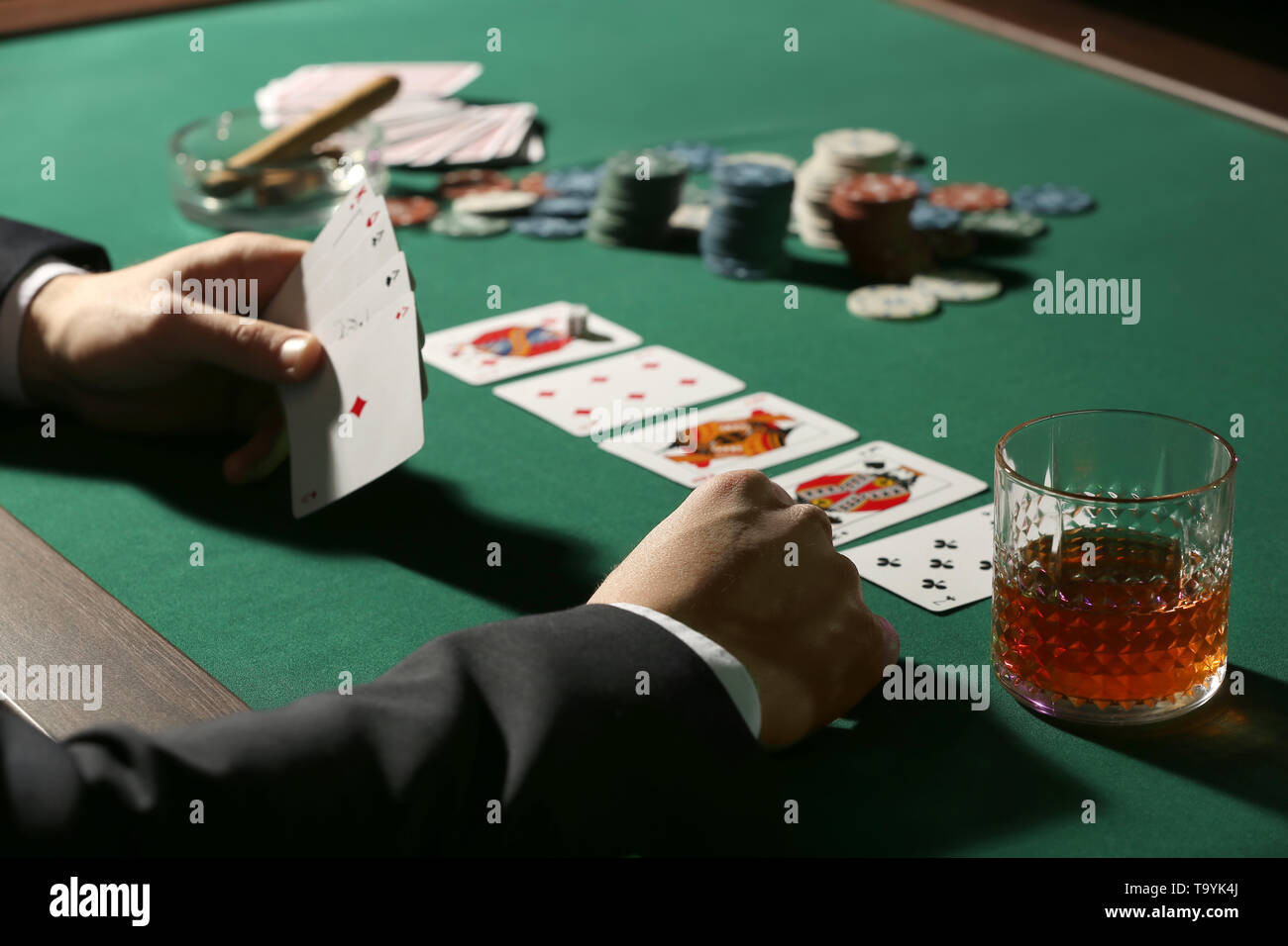 Male player at table in casino - Stock Image