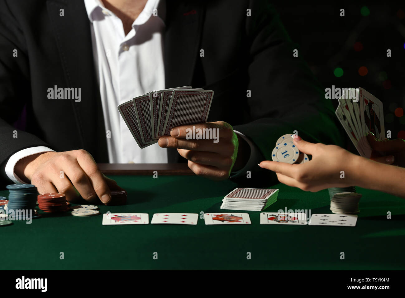 Players at table in casino - Stock Image
