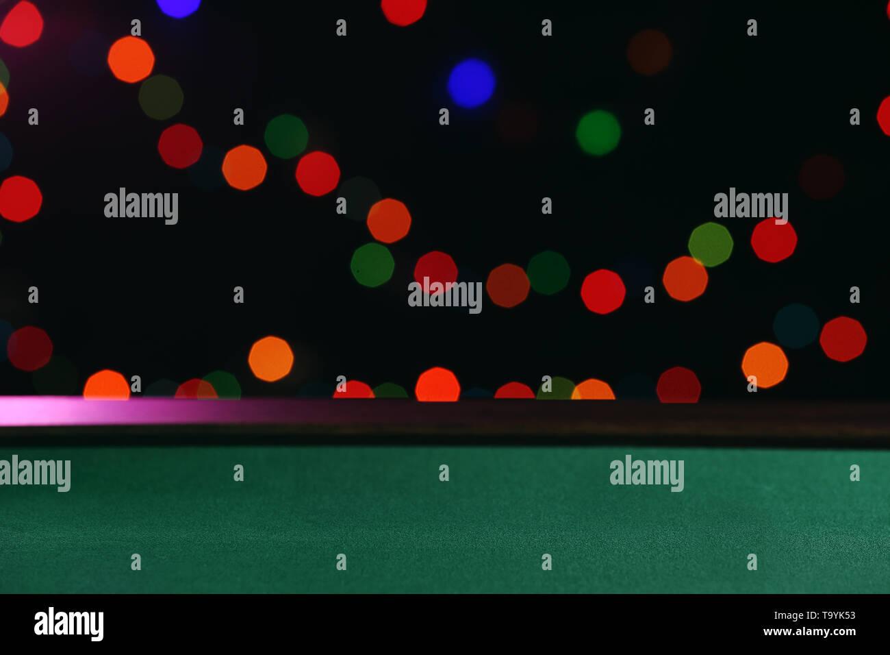 Table in casino against defocused lights - Stock Image
