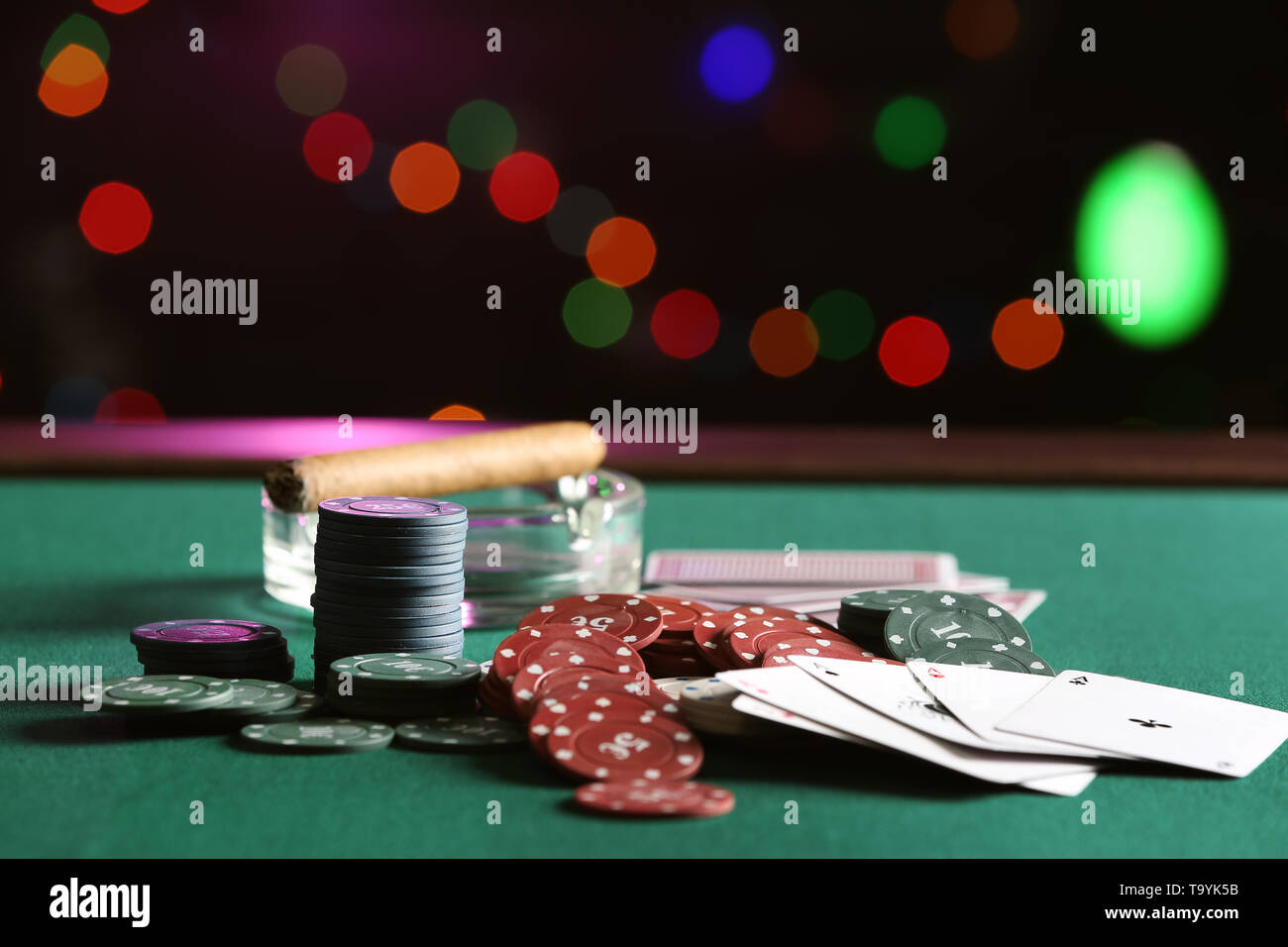 Chips and cards on table in casino - Stock Image