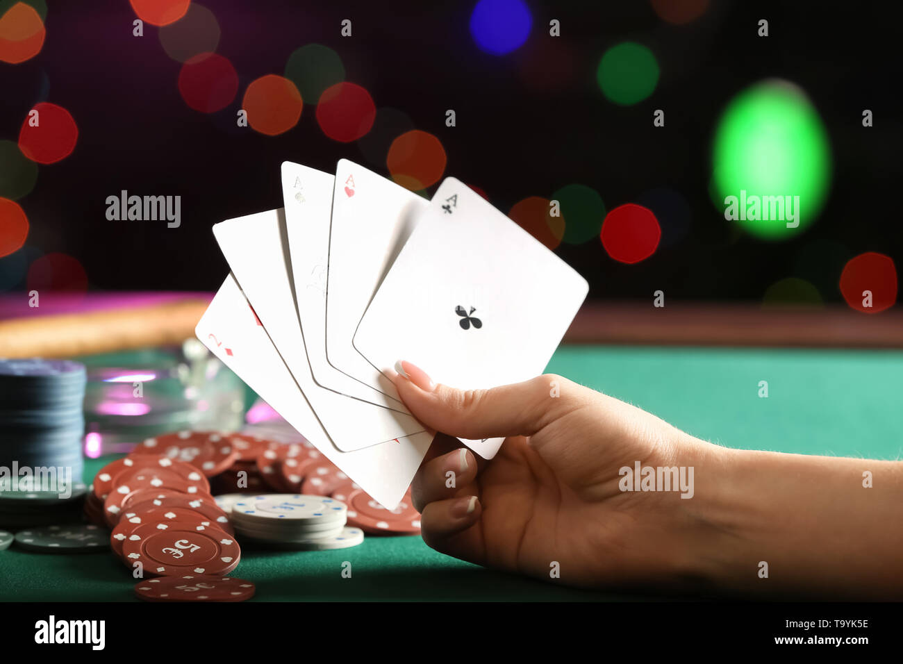Woman playing cards in casino, closeup - Stock Image