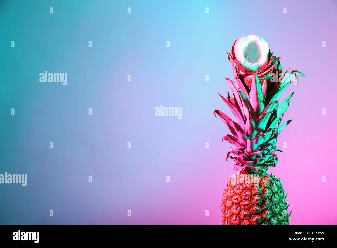 Fresh pineapple and coconut on color background - Stock Image