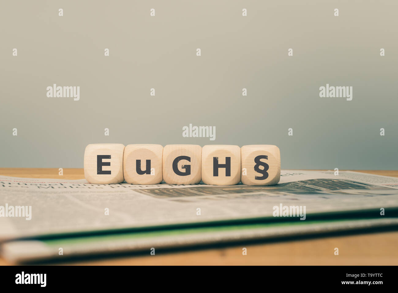 Symbol for a decision of the European Court of Justice. The German abbreviation 'EuGH' (stands for European Court of Justice ECJ) written on cubes pla - Stock Image