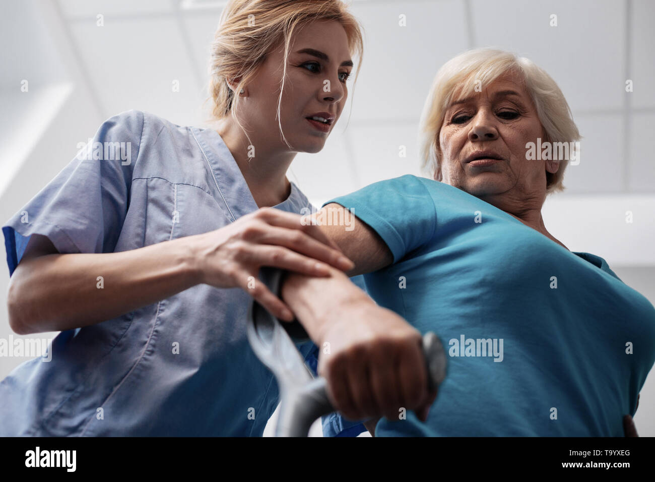 Low angle of a nice female patient - Stock Image