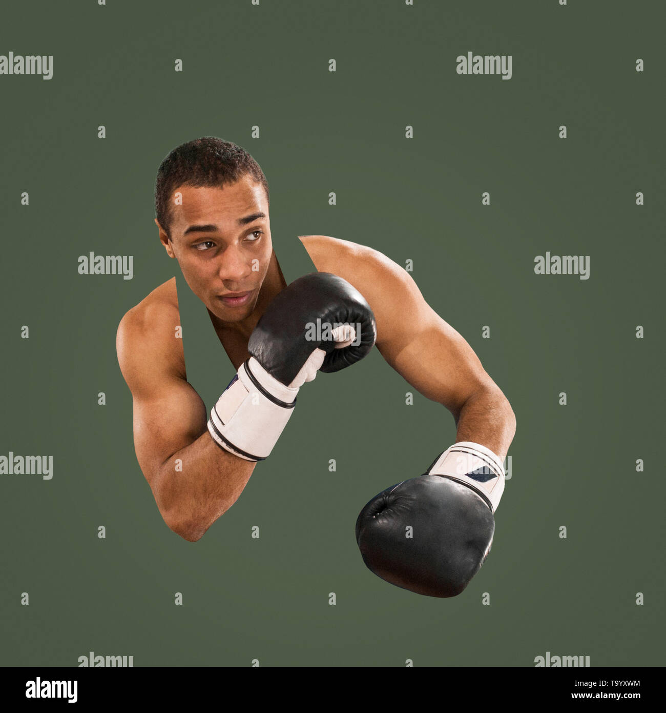 Sporty man during boxing exercises. Photo of boxer on isolated on green background. Strength, attack and motion concept. Fit african american model in - Stock Image