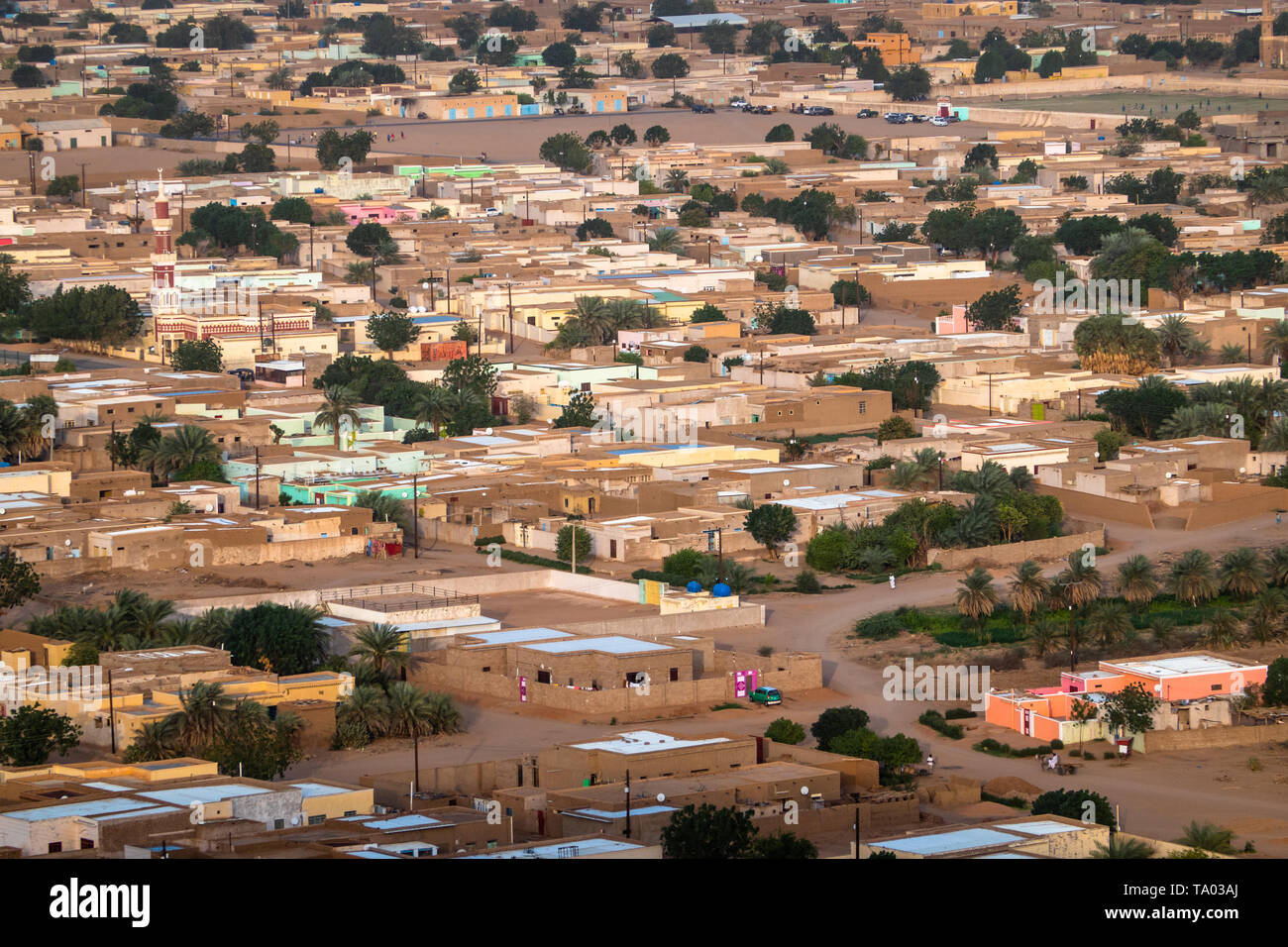 Aerial view of a typical village in Sudan near the Nile, with flat loam buildings and colourful doors, Africa - Stock Image