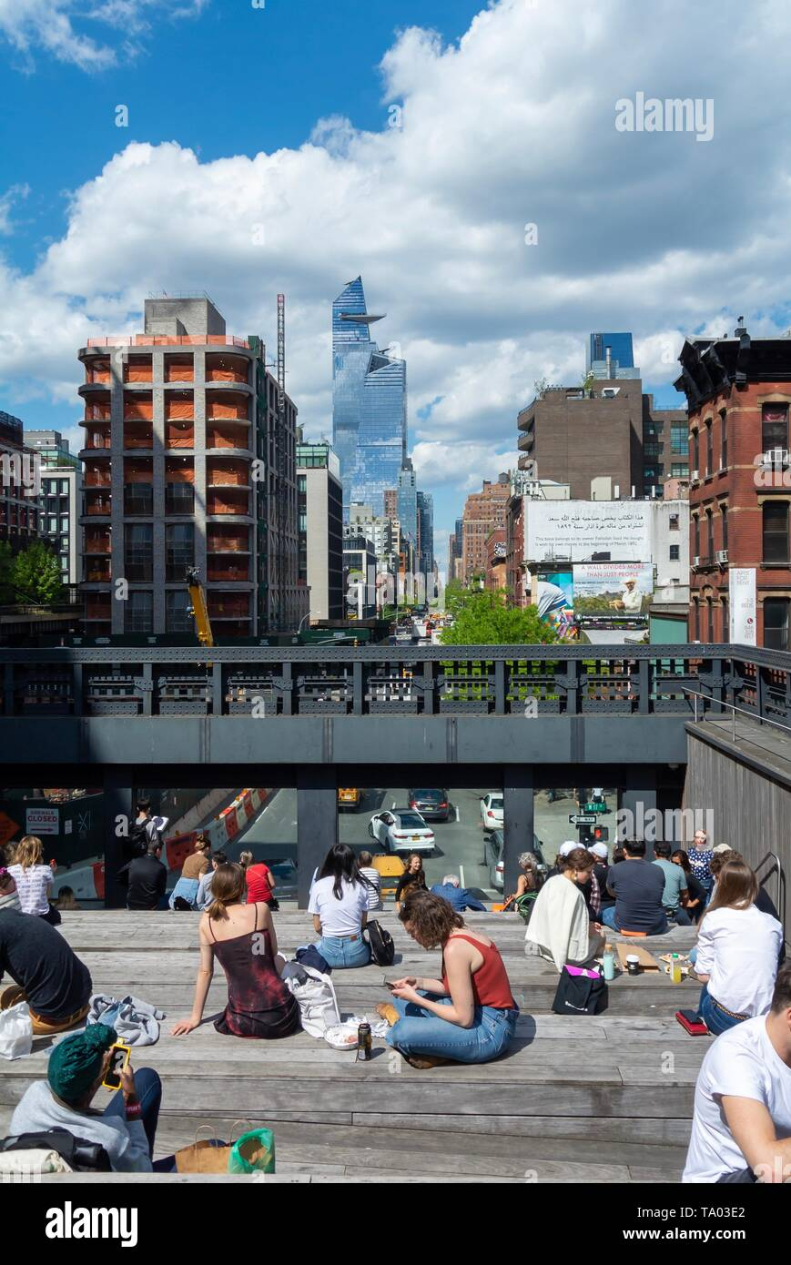 People relaxing at the high line, urban park redeveloped from an abandoned elevated rail line in Chelsea, Manhattan New york city, NY / USA Stock Photo