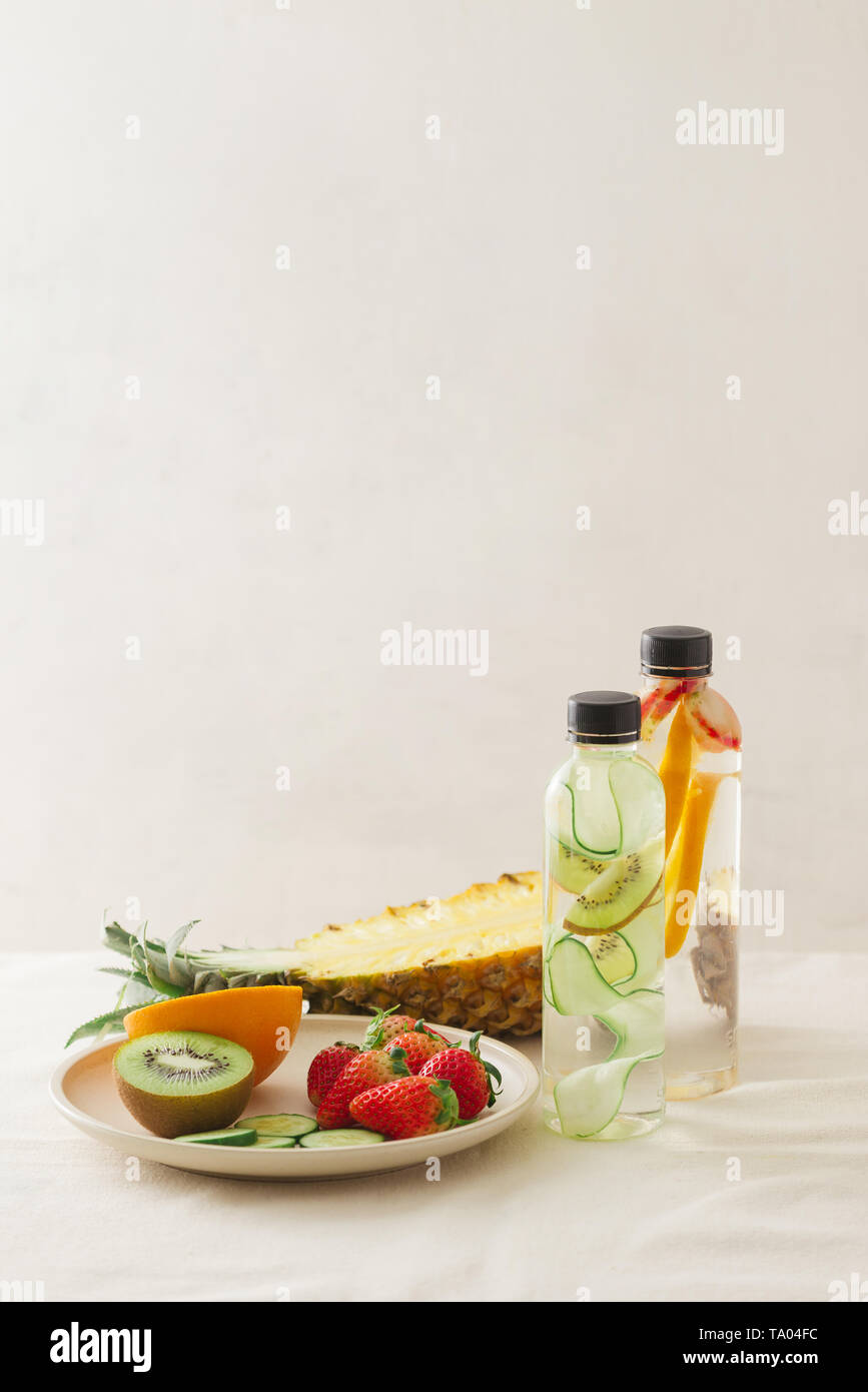 Sliced fresh organic fruits prepared to make infused water - Stock Image