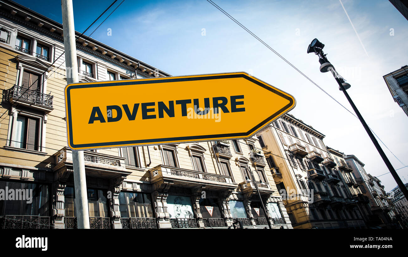 Street Sign the Direction Way to to Adventure - Stock Image