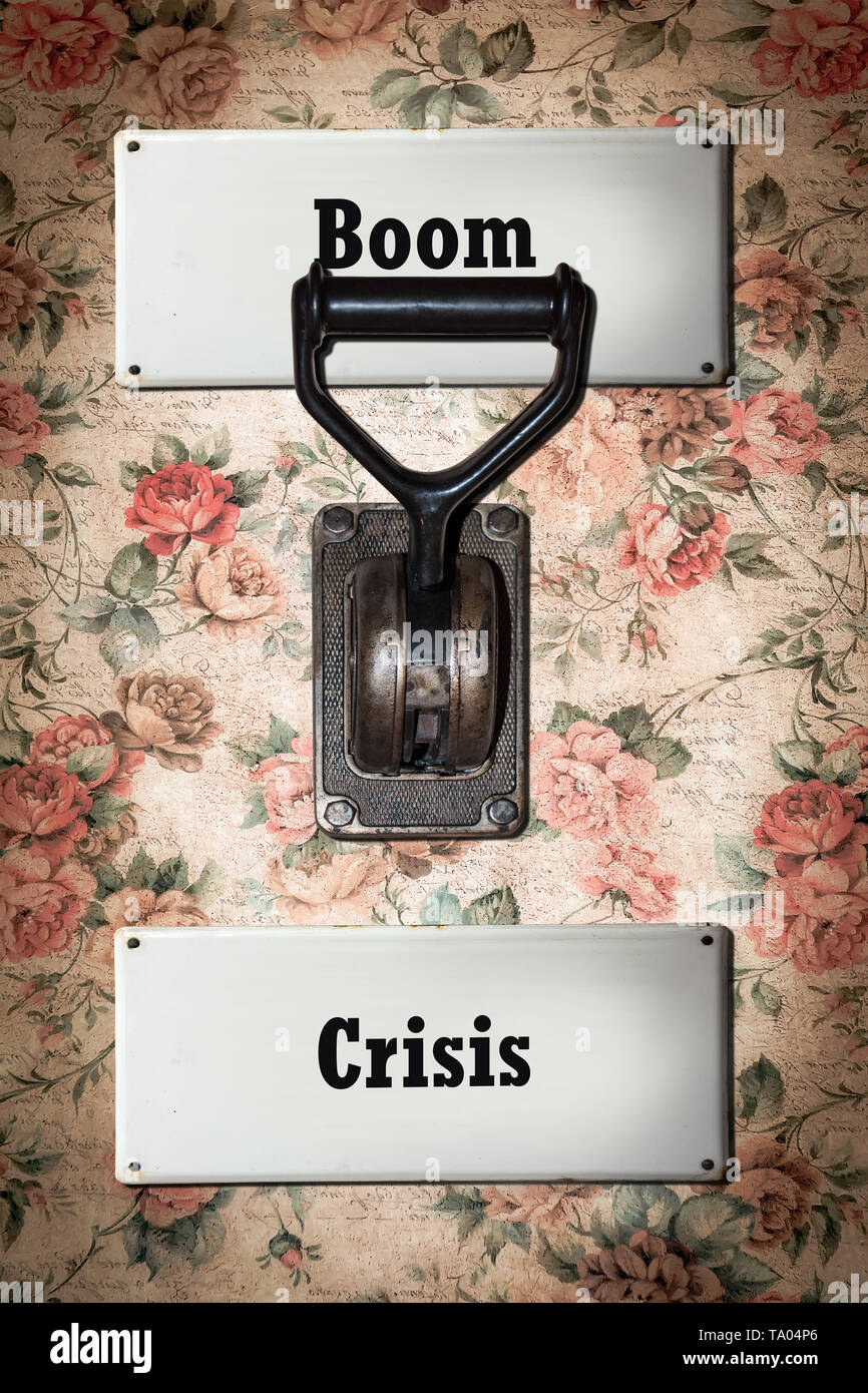 Street Sign the Direction Way to Boom versus Crisis - Stock Image