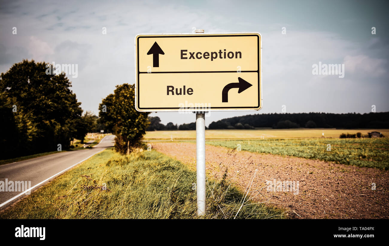 Street Sign the Direction Way to Exception versus Rule - Stock Image