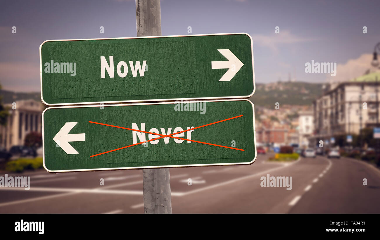 Street Sign the Direction Way to Now versus Never - Stock Image