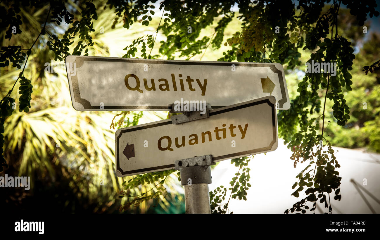 Street Sign the Direction Way to Quality versus Quantity - Stock Image