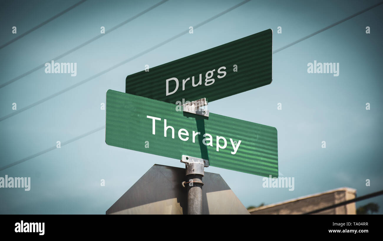 Street Sign the Direction Way to Therapy versus Drugs - Stock Image