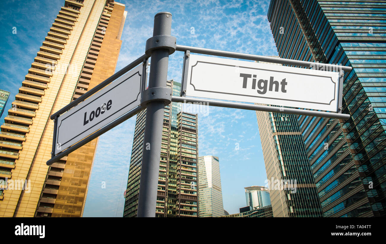 Street Sign the Direction Way to Tight versus Loose - Stock Image