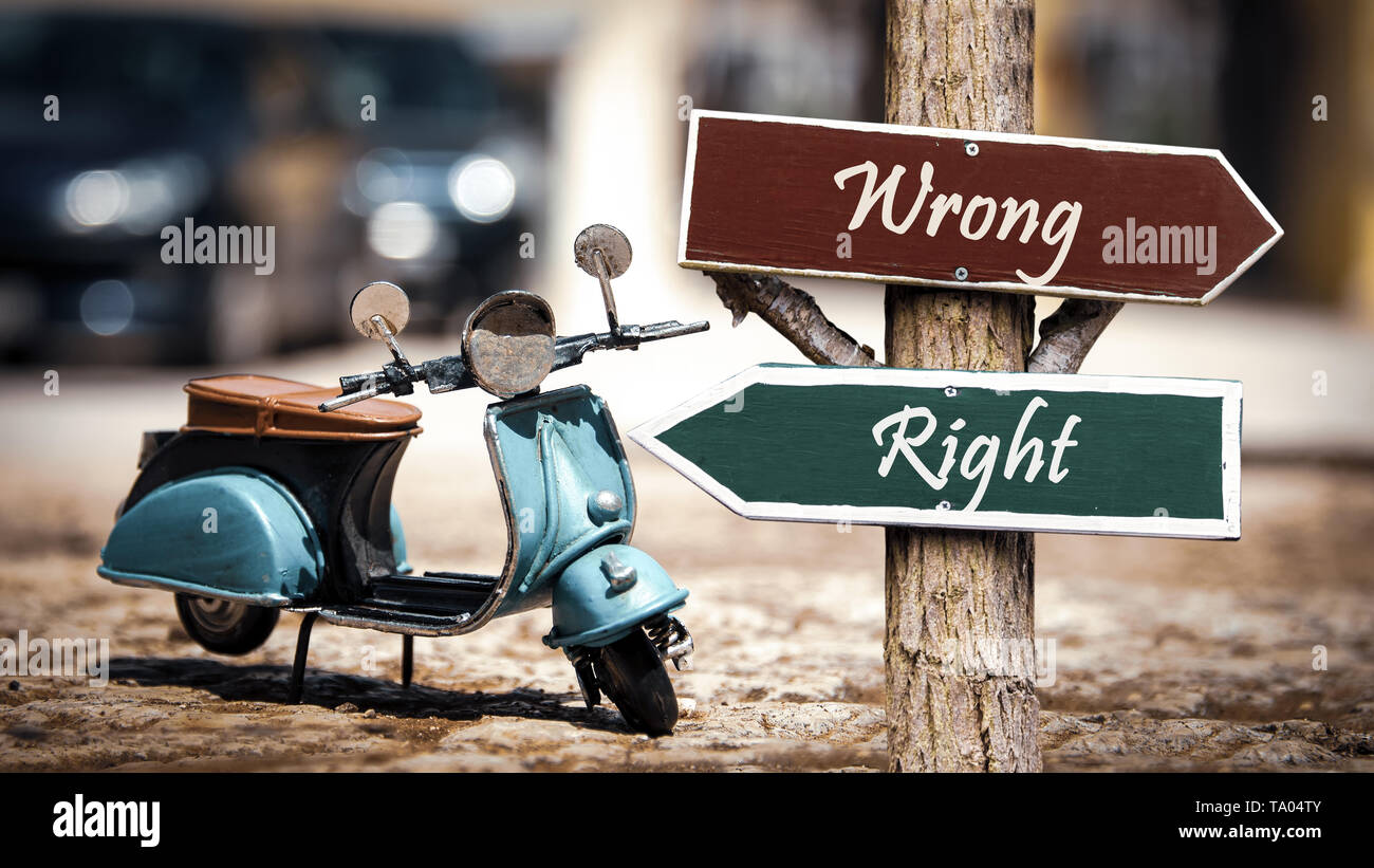 Street Sign the Direction Way to Right versus Wrong - Stock Image