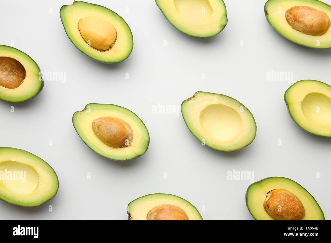 Plenty of fresh avocados on white background - Stock Image
