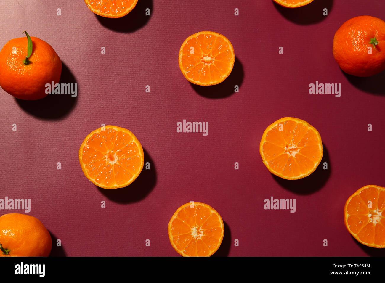 Plenty of fresh tangerines on color background - Stock Image