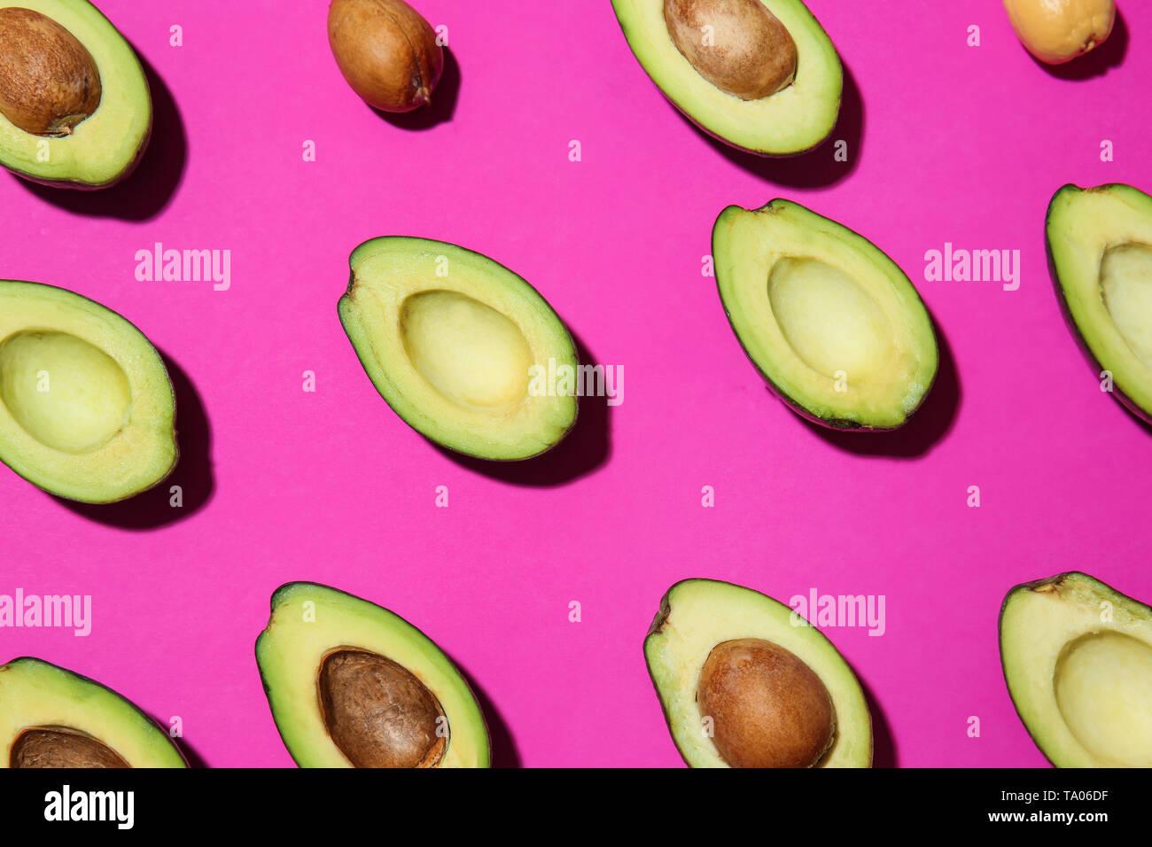 Plenty of fresh avocados on color background - Stock Image