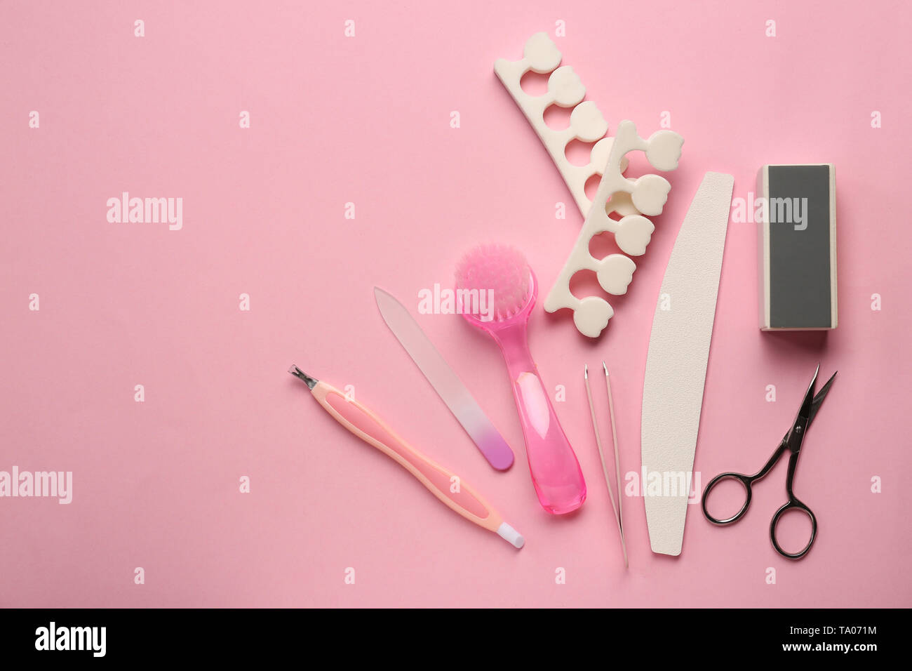 Set of pedicure tools on color background - Stock Image
