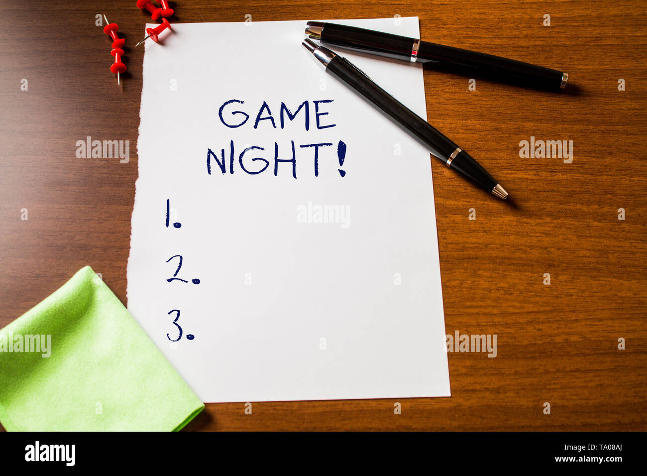 Text sign showing Game Night. Business photo showcasing usually its called on adult play dates like poker with friends Blank stationary paper wooden t - Stock Image