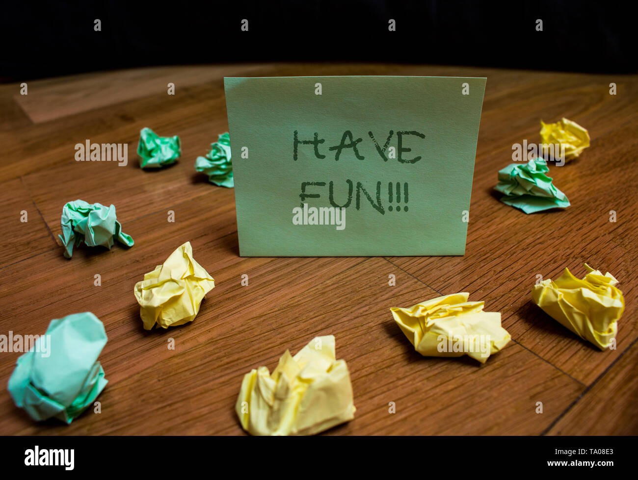 Handwriting text Have Fun. Conceptual photo wish somebody good and enjoyable time when they do something Colored small wrinkled paper balls standing s - Stock Image