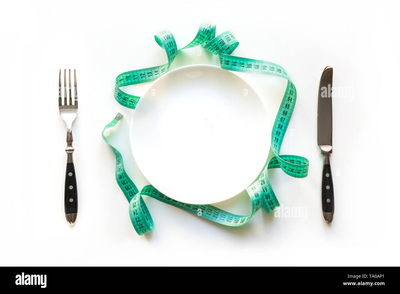 White table setting with tape measure. Concept weight loss for Detox. View from above. - Stock Image
