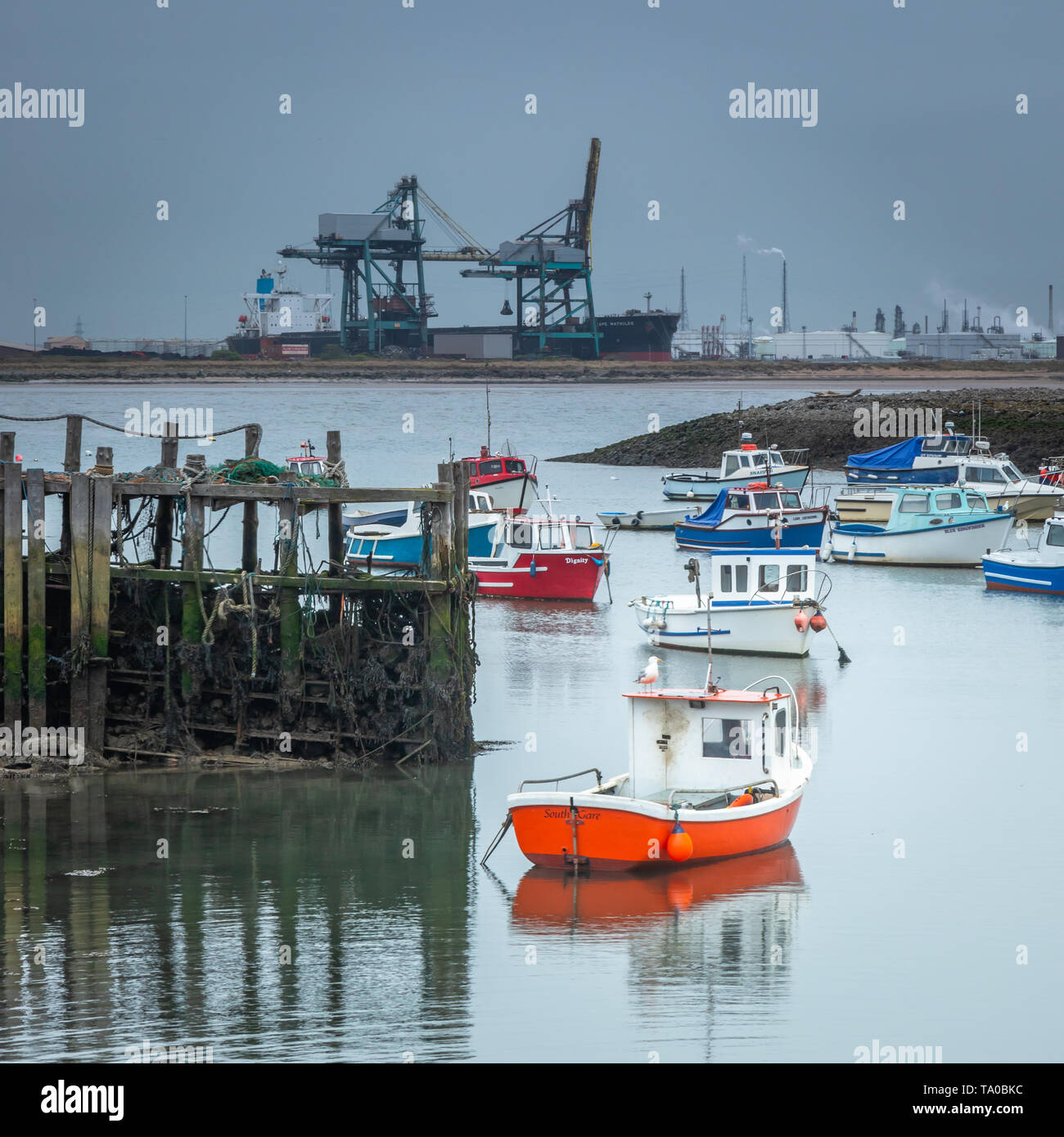 Small Boat Harbour  at South Gare, near Redcar Teeside,  The Steelworks near Middlesborough in the background taken early May 2019 - Stock Image