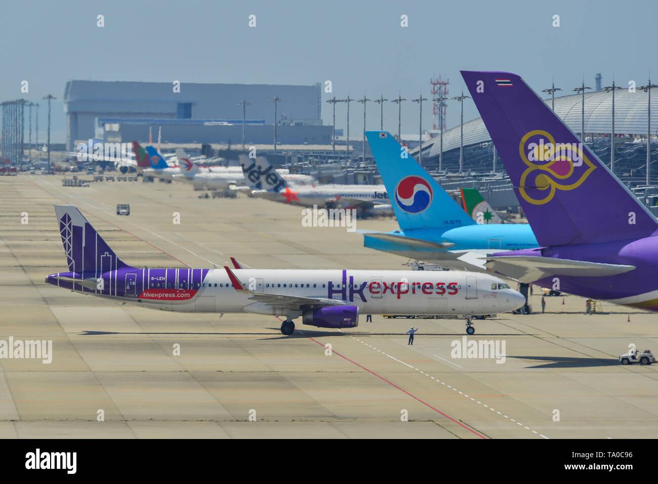 Osaka, Japan - Apr 18, 2019.  B-LEH Hong Kong Express Airbus A321 taxiing on runway of Kansai Airport (KIX) in Osaka, Japan. - Stock Image
