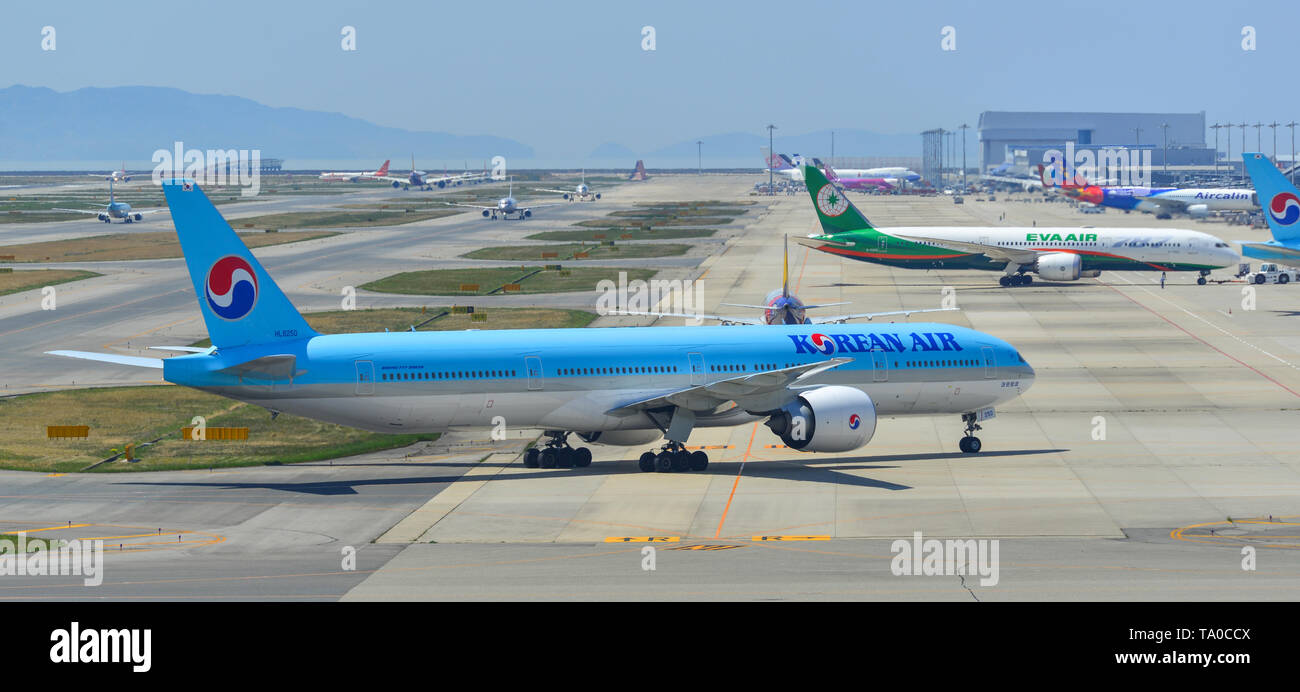 Osaka, Japan - Apr 18, 2019.  Passenger airplanes taxiing on runway of Kansai Airport (KIX) in Osaka, Japan. - Stock Image