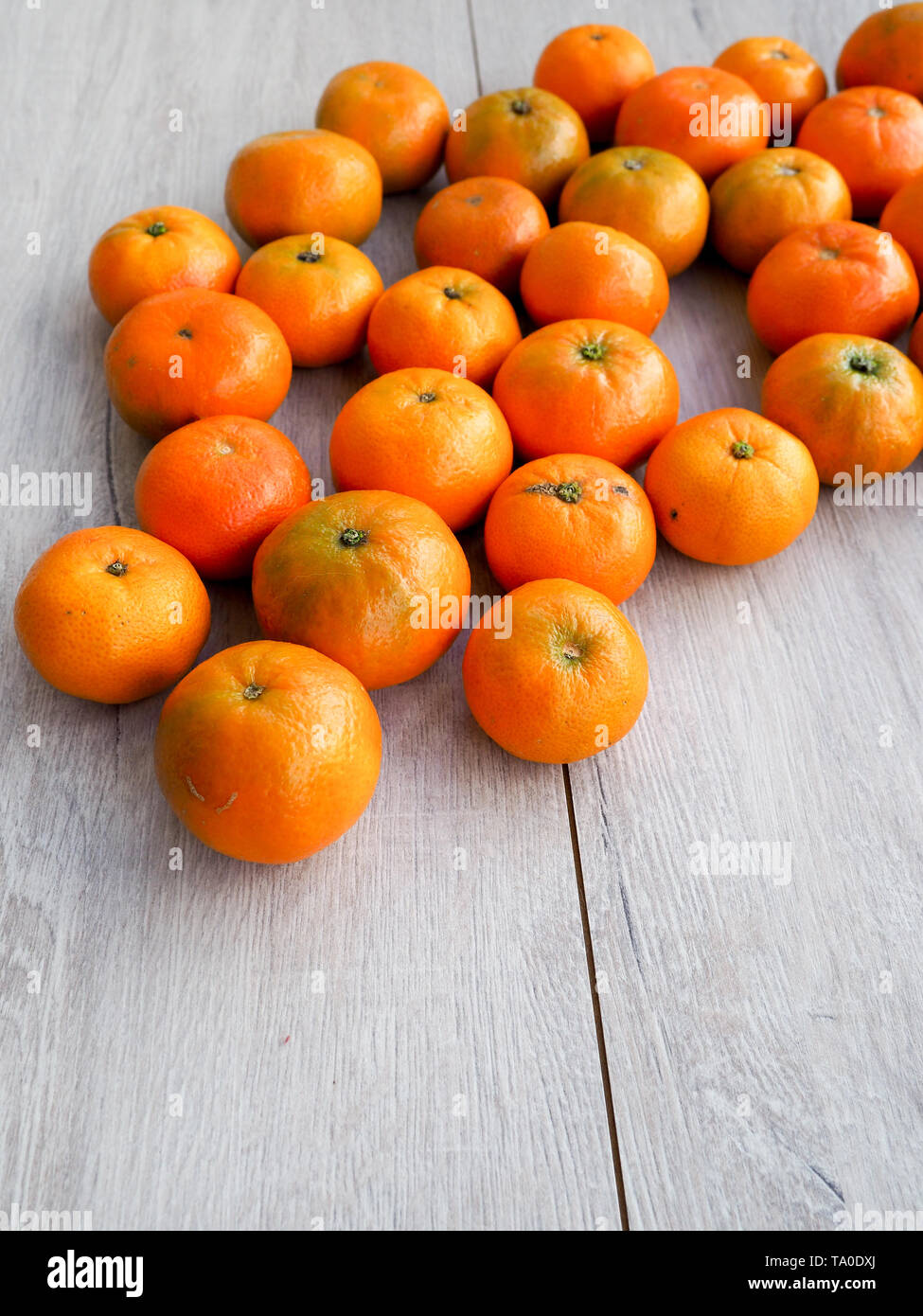 fresh Mandarin oranges as a background, cover, space for text - Stock Image