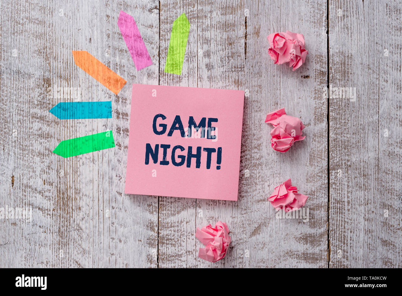 Handwriting text writing Game Night. Conceptual photo usually its called on adult play dates like poker with friends Plain note paper and line arrow s - Stock Image
