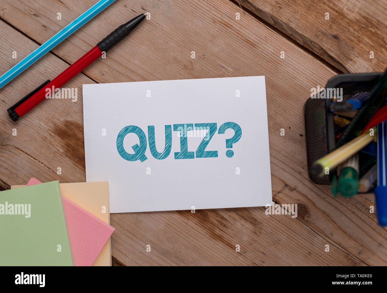 Conceptual hand writing showing Quiz Question. Concept meaning test of knowledge as competition between individuals or teams Note papers and stationar - Stock Image