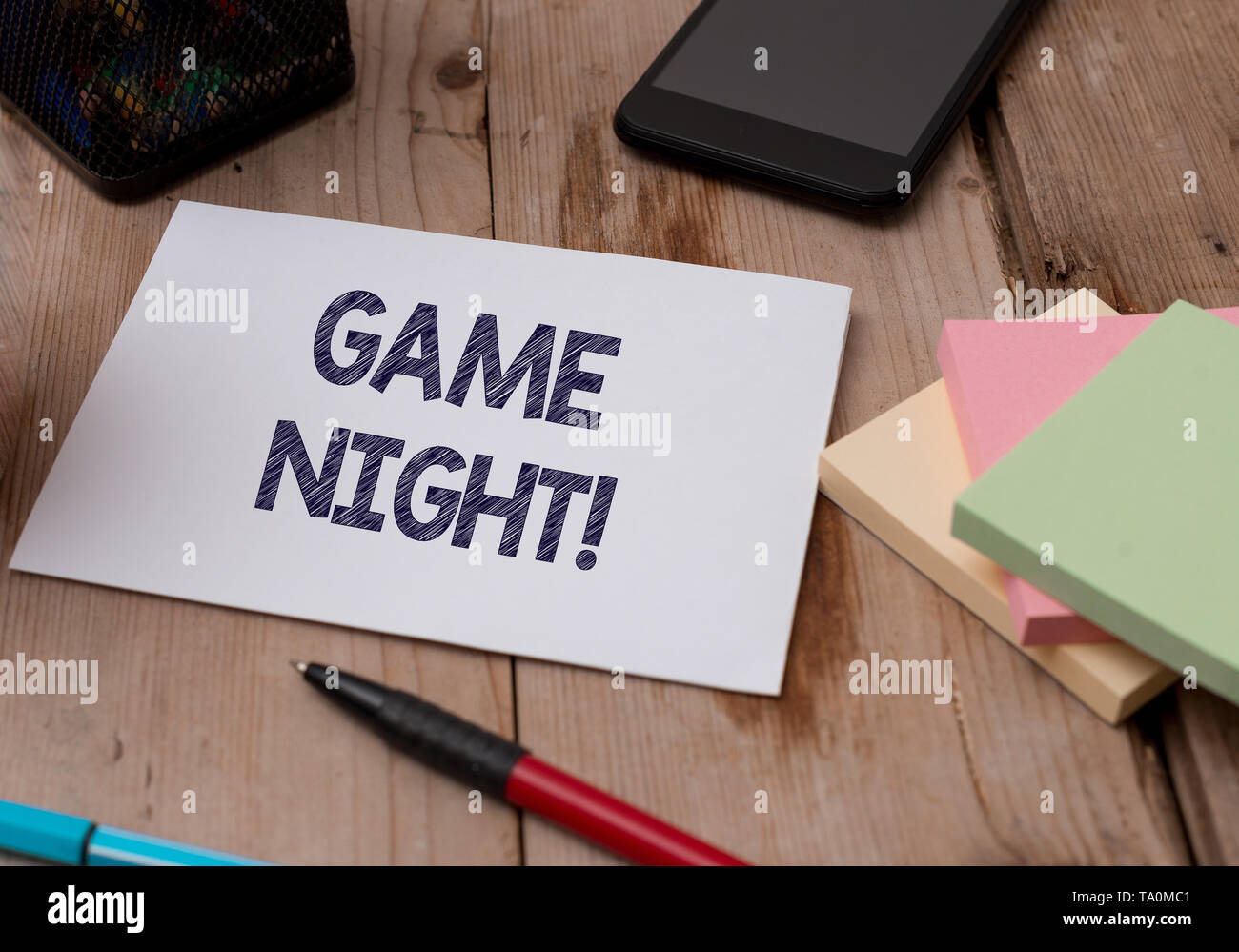 Word writing text Game Night. Business photo showcasing usually its called on adult play dates like poker with friends Top view wooden table stationar - Stock Image