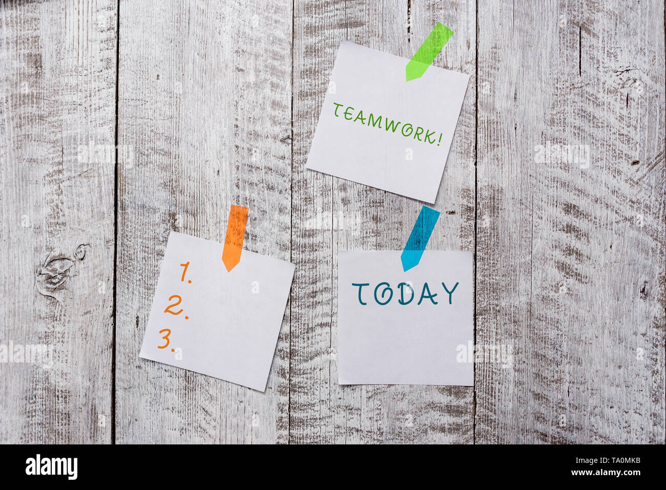 Conceptual hand writing showing Teamwork. Concept meaning combined action of group especially when effective and efficient Plentiful of plain paper sh - Stock Image
