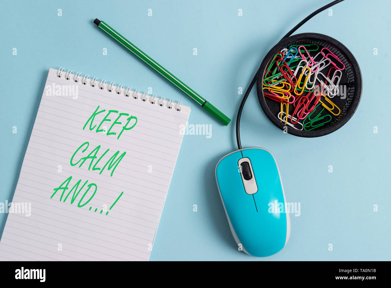 Handwriting text Keep Calm And. Conceptual photo motivational poster produced by British government - Stock Image