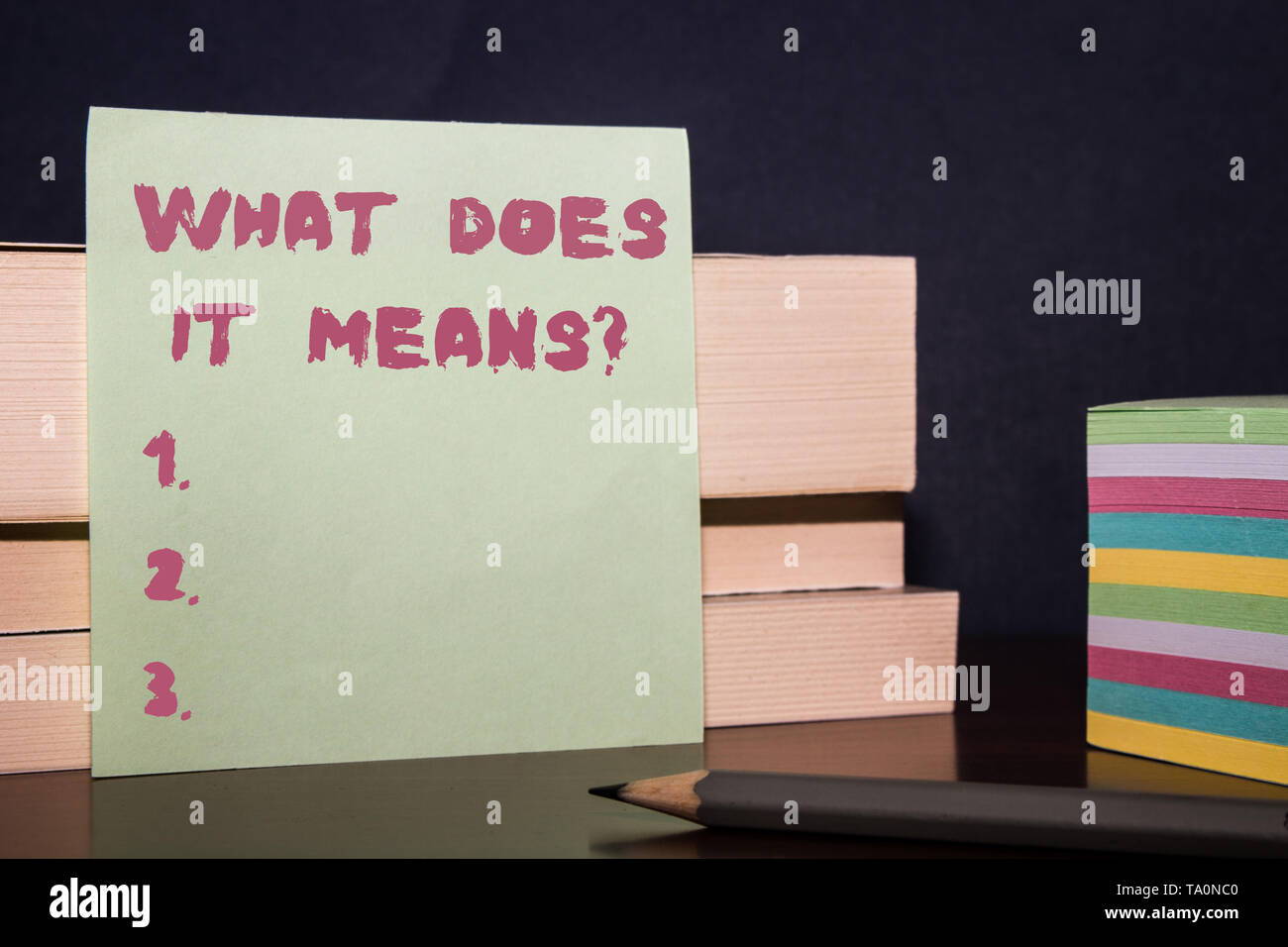 Conceptual hand writing showing What Does It Means question. Concept meaning asking meaning something said and do not understand Close up three wooden - Stock Image