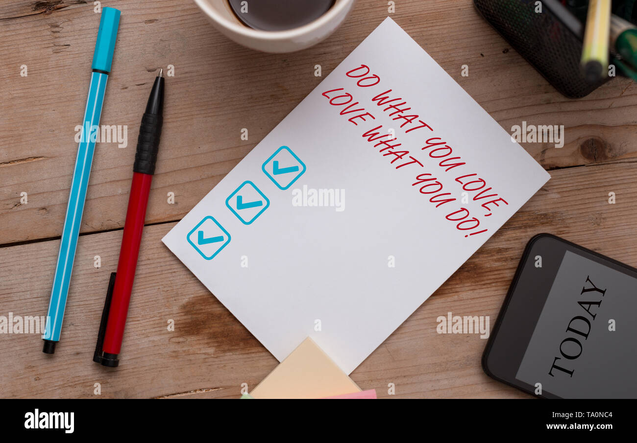 Writing note showing Do What You Love Love What You Do. Business concept for you able doing stuff you enjoy it to work in better places then Wooden ta - Stock Image